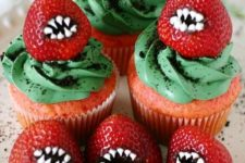 28 monster strawberry cupcakes with green frosting look scary but are very tasty