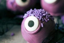 29 monster truffles in purple are a bold idea for a kids' party dessert table
