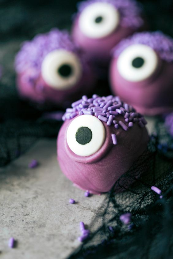 monster truffles in purple are a bold idea for a kids' party dessert table