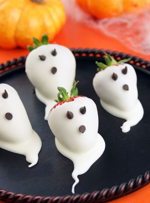 simple ghost strawberries in white chocolate and chocolate chips