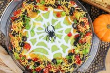 33 spider web taco dip will be a great fit for both an adult and a kid party