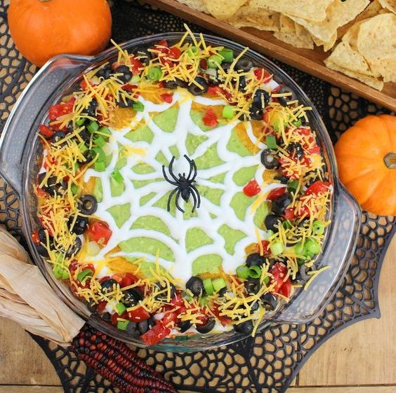 spider web taco dip will be a great fit for both an adult and a kid party
