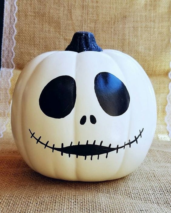 Jack Skellington pumpkin done with black paint is an easy craft even for a beginner