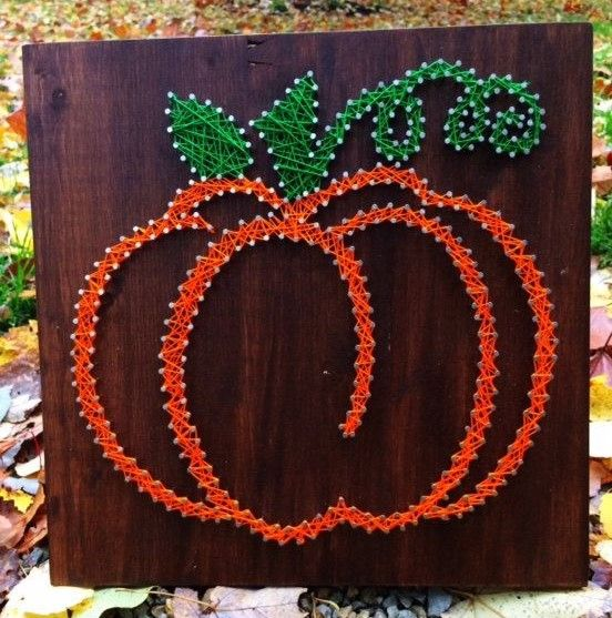 a chic contour pumpkin string art with green leaves