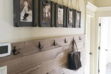 02 an entryway clad with stained pallet wood gets a rustic touch automatically