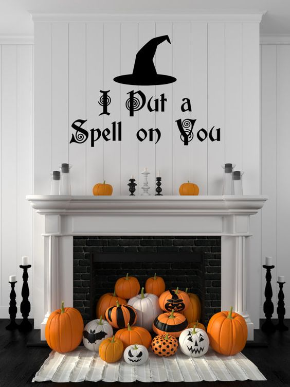 a fireplace pumpkin display - striped and painted pumpkins for Halloween