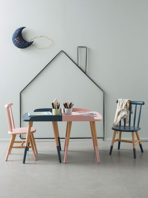 a fun play and study nook with two desks and a house and moon for decor