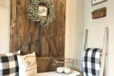 03 a whitewashed wooden bench and a repurposed bard door as a wall decoration