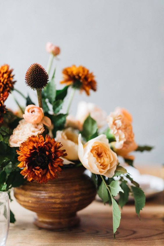 burnt orange, peachy and blush blooms with lots of greenery for a calm fall look