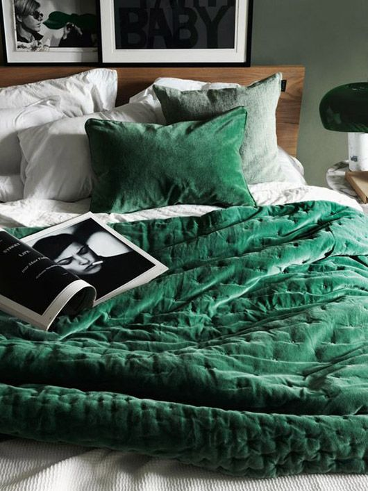 an emerald blanket and pillow are all you need to add to give your bed a fall look