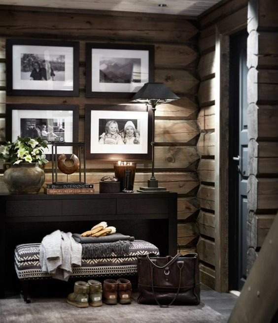 a cabin feel in this entryway is created with unique wood wall covering
