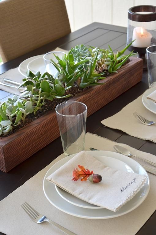 clean and simplistic Thanksgiving tablescape with a wood box planter and succulents