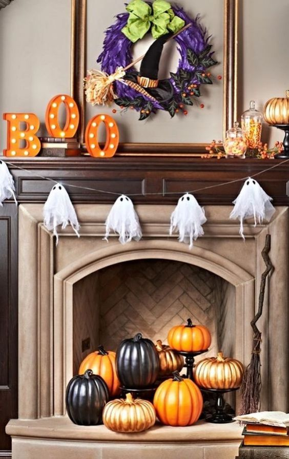 place black, orange and gold pumpkins on stands inside the fireplace to make it look awesome