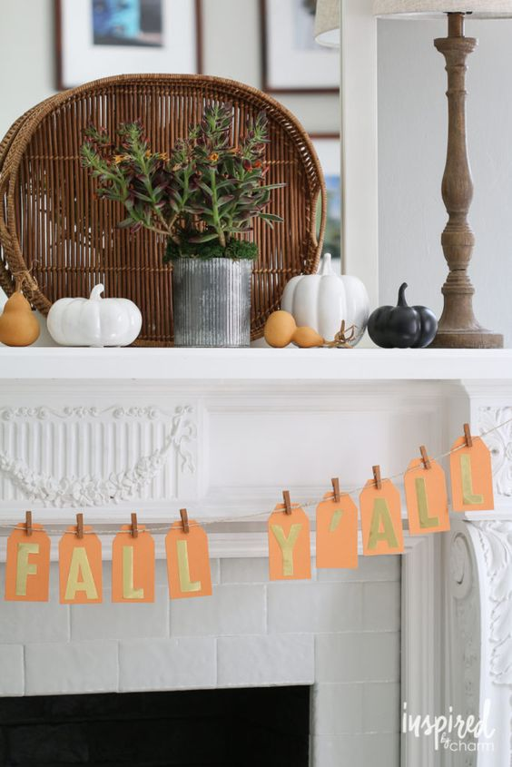 a modern mantel with porcelain pumpkins and pears, succulents and a bread basket for a cozy feel