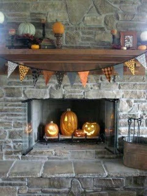 place some Jack-o-lanterns inside your fireplace to make it Halloween-like