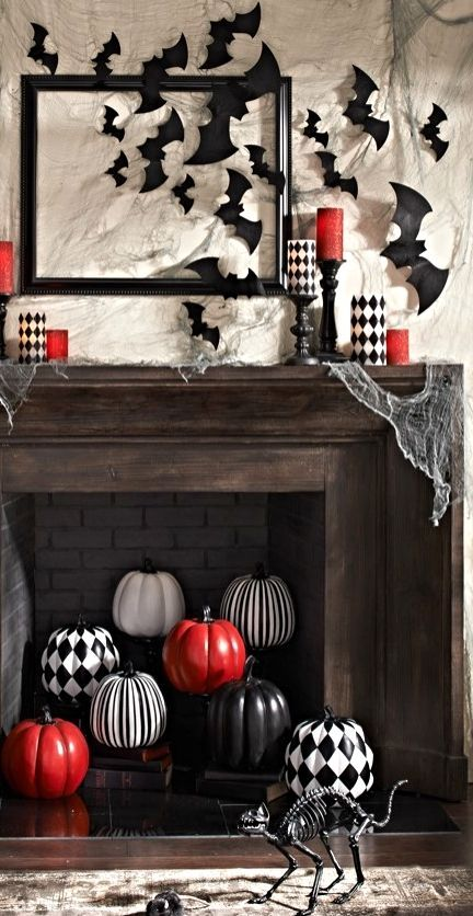 a fireplace with striped, checkered and red pumpkins looks bold and eye-catchy