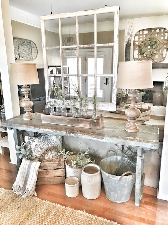 a rustic patina console table, some crates for storage and some buckets