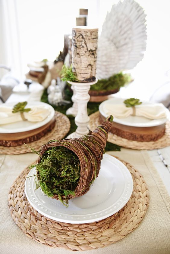 a tiny cornucopia filled with moss to mark the place setting