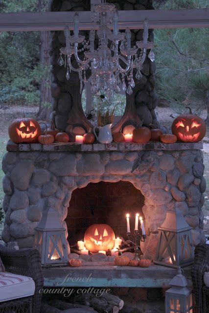 a cool display with a JAck-o-lantern, pumpkins and candles