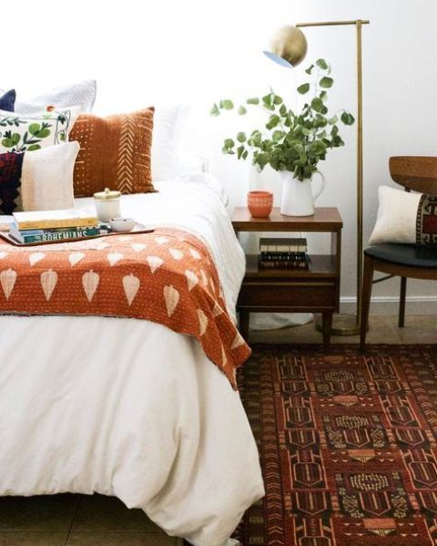 add a touch of fall shades with an burnt orange printed bedspread and a printed pillow