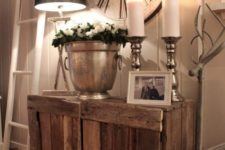 09 a simple rustic wooden cabinet and a large clock create a cozy farmhouse space
