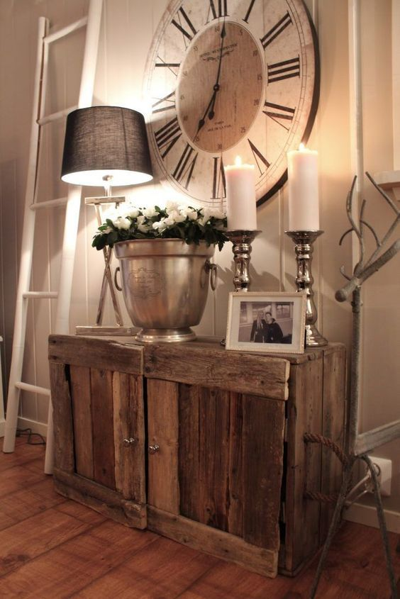 a simple rustic wooden cabinet and a large clock create a cozy farmhouse space
