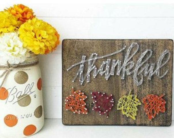 a cool Thankful sign with colorful fall leaves is a gorgeous string art