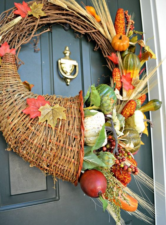 a cornucopia fall wreath with leaves, wheat, faux pumpkins for a front door