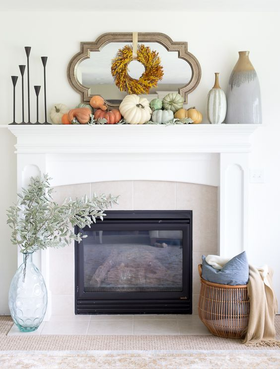 a fresh take on rustic decor with various natural pumpkins and a fall leaf wreath