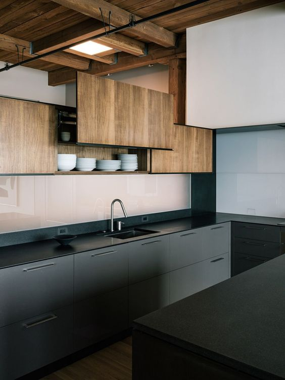 a modern kitchen with wooden and metal cabinets, grey and natural wood contrast each other