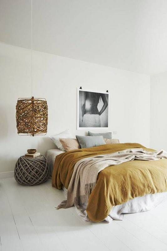 a mustard bedspread, some beige pillows and greys show off the popular fall colors