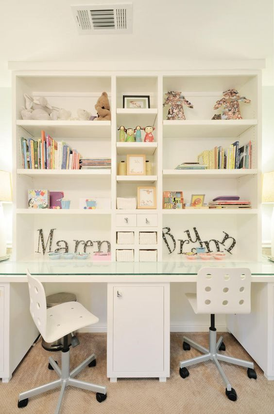 a playful study space for both kids with lots of storage space for books and toys
