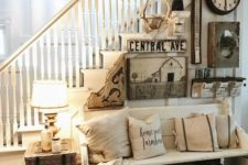 11 a vintage whitewashed wooden bench and some baskets makes the entry rustic