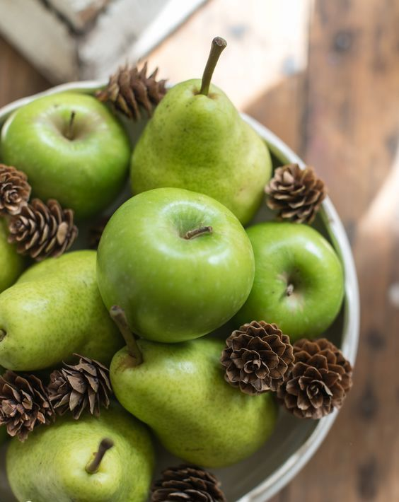 green apples, pears and pinecones to display in a bowl look cool