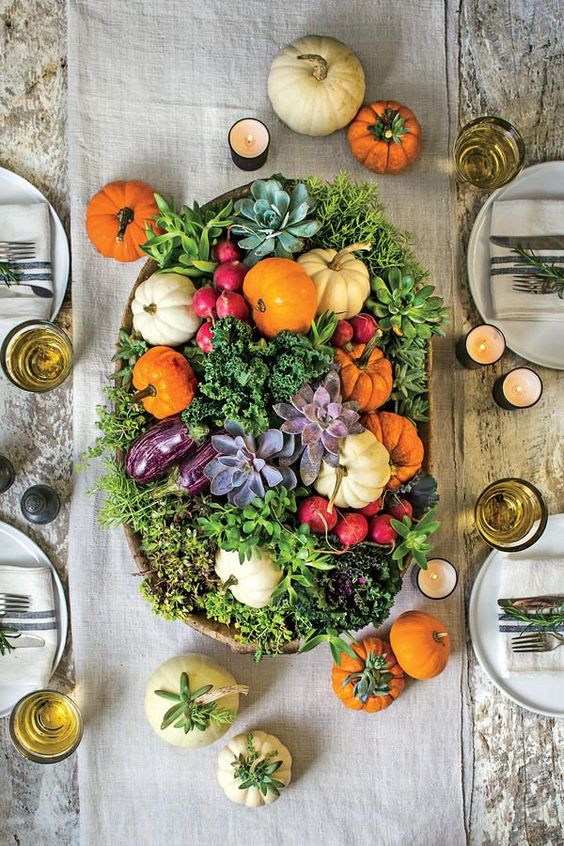 a bowl with greenery, succulents, radish, pumpkins and lettuce
