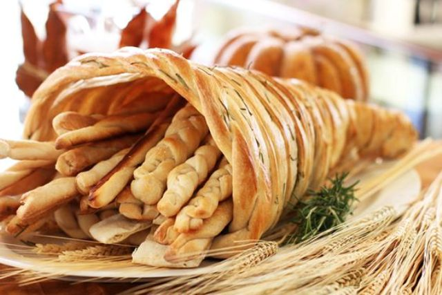 a bread cornucopia filled with bread sticks is a great treat for Thanksgiving
