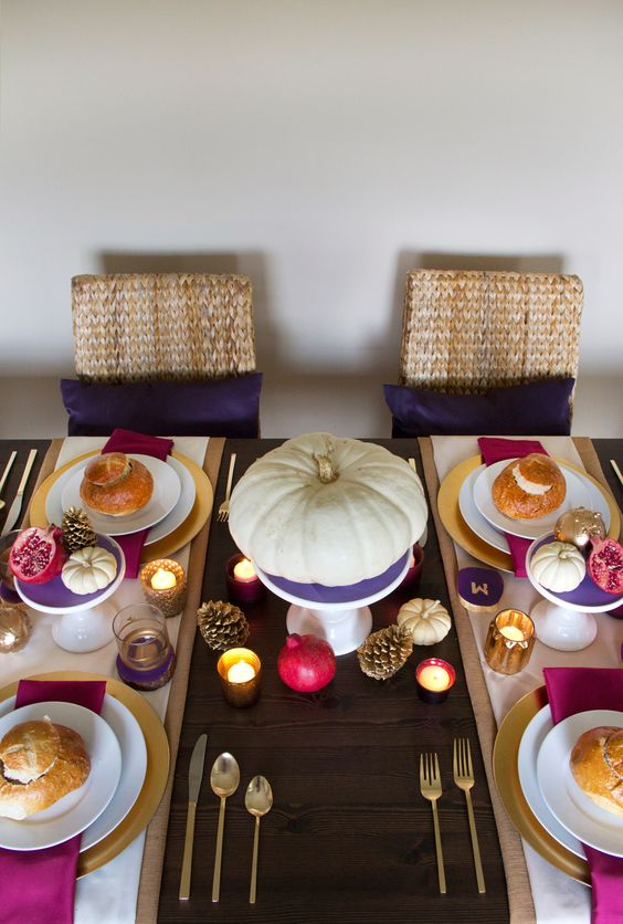 a colorful modern tablescape in purple, fuchsia and gold, with pumpkins and pinecones look super cheerful