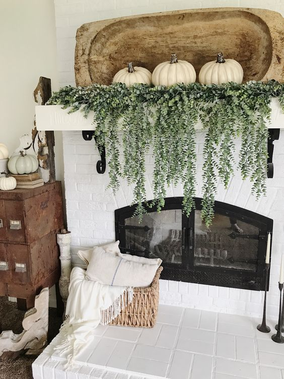 a large shabby chic bread bowl, cascading greenery and three white pumpkins are a great idea for a mantel