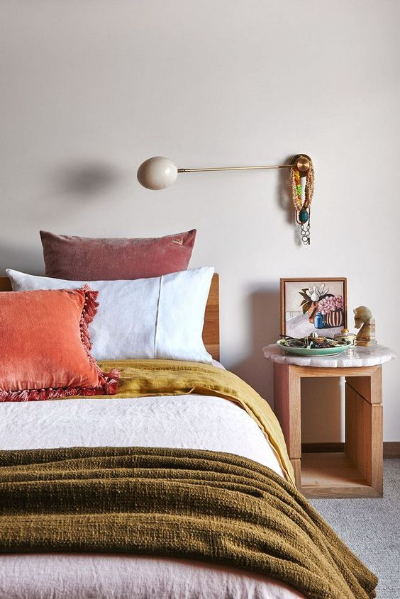 add mustard, olive green and orange as pillows and blankets for a cute fall feel