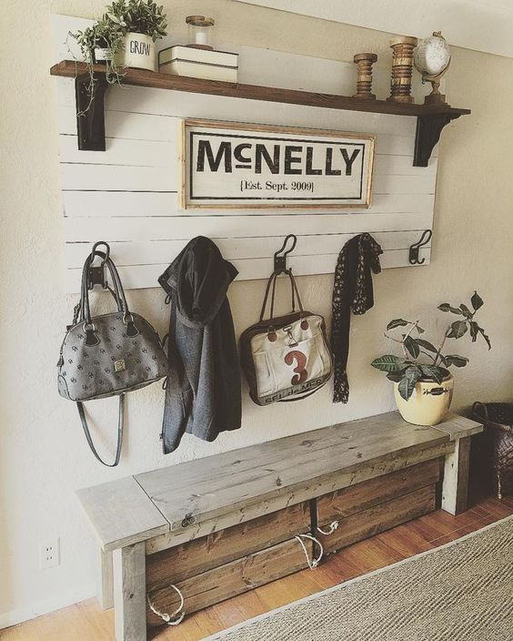 Fresh a wooden bench with drawers underneath and a wooden shelf over it for a rustic space