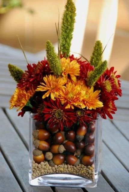 orange and burgundy blooms, nuts inside the vase for a fall look