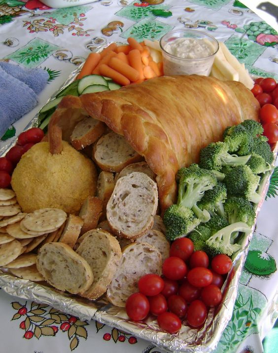 a bread cornucopia with bread and various veggies for a creative holiday tray