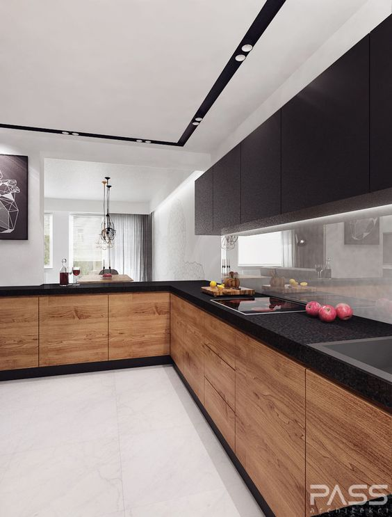 a modern kitchen with wooden cabinets and black metal countertops and hanging cabinets