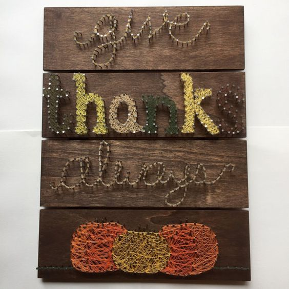 a rustic string art sign with pumpkins and words 'Give Thanks Always'
