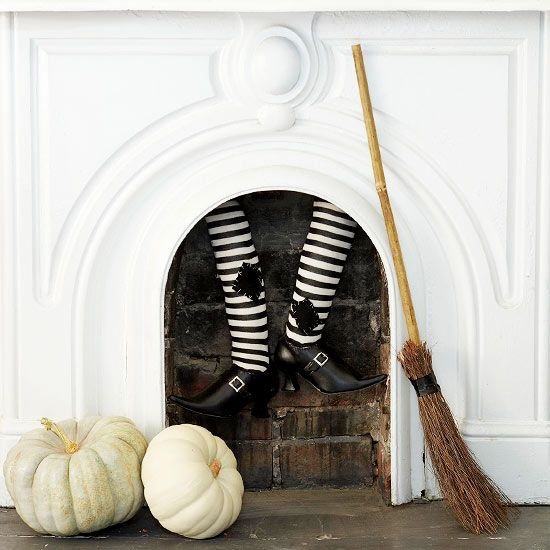attach faux witch's legs, add a broom and some white pumpkins for Halloween