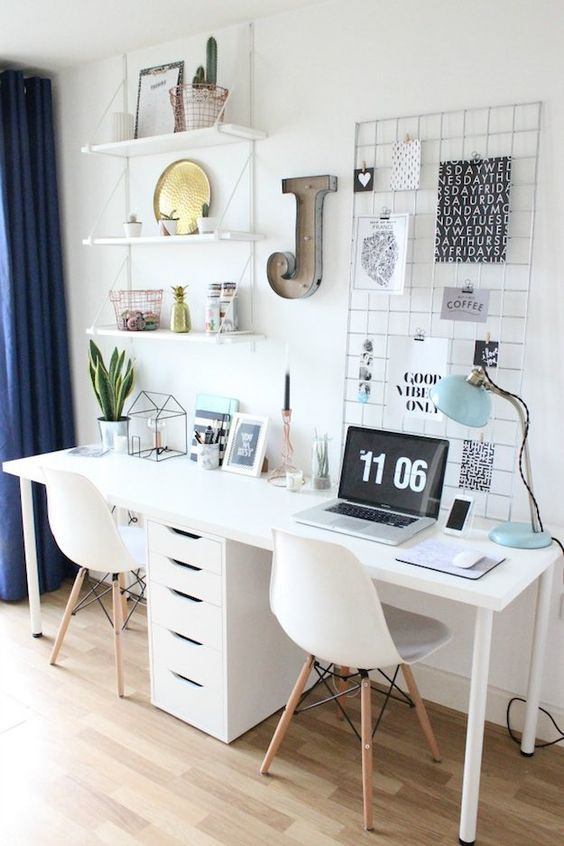 an airy Scandinavian space with a double white desk and a row of drawers for both