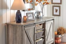 15 giving a rustic feel with a wooden furniture piece is a simple and cool idea, here it's a sideboard with a vintage flavor