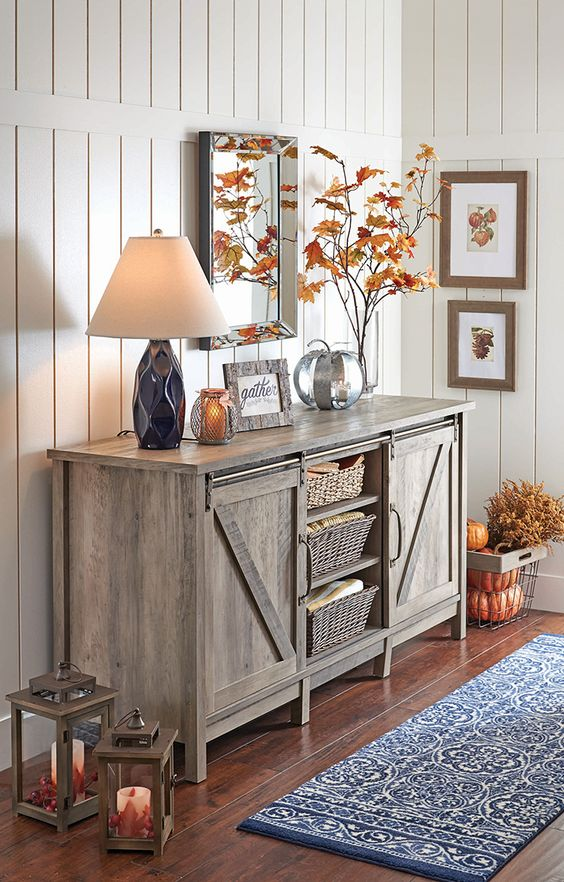 giving a rustic feel with a wooden furniture piece is a simple and cool idea, here it's a sideboard with a vintage flavor