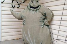 16 Oogie Boogie constructed out of burlap, glow in the dark paint and stuffed full of plastic grocery shopping bags