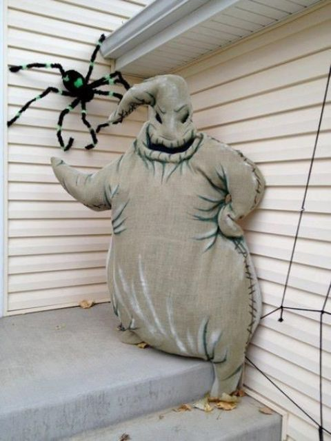 Oogie Boogie constructed out of burlap, glow in the dark paint and stuffed full of plastic grocery shopping bags